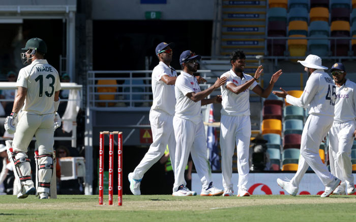 India's Thangarasu Natarajan (C) celebrates his wicket of Australia's batsman Matthew Wade(L) with teammates on day one of the fourth cricket Test match between Australia and India at The Gabba in Brisbane on 15 January 2021. Picture: David Kapernick/AFP