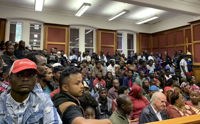 Foreign nationals in the Western Cape High Court in Cape Town on 17 February await the ruling that will decide if they will be removed from the Methodist Church in Greenmarket Square. Picture: Kaylynn Palm/EWN