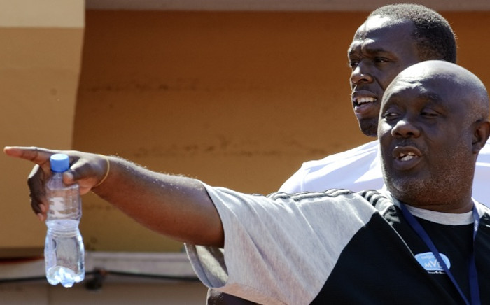 Olympic gold medallist Usain Bolt with his coach Glen Mills during a practice session. Picture: AFP
