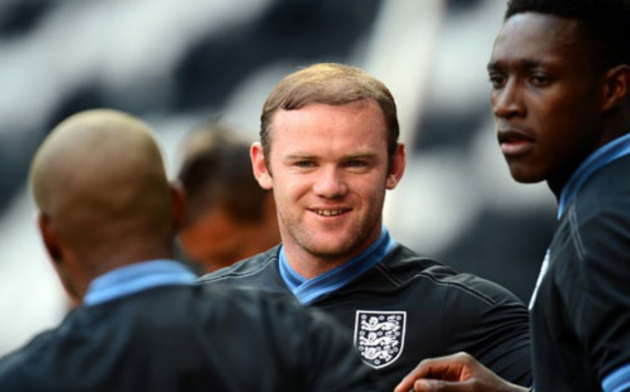 England's forward Wayne Rooney (C) and English forward Dany Welbeck (R) take part in a training session at the Dombass Arena stadium in Donetsk on 10 June, 2012. Picture: AFP