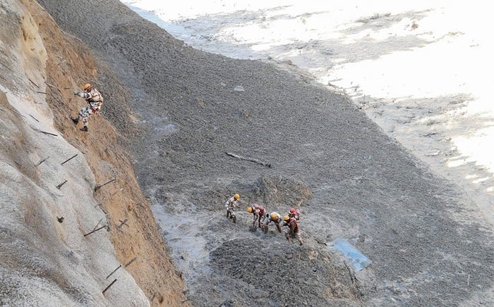 This handout photograph provided by the Indo Tibetan Border Police and taken on 7 February 2021 shows Indo Tibetan Border Police personnel during a rescue operation to clear Tapovan tunnel from debri following floods after glacier broke off in Chamoli district. Picture: AFP