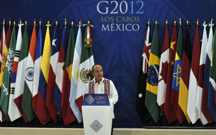 Mexican President Felipe Calderon welcomes dignitaries to the G20 Summit in Los Cabos, Mexico. Picture: Cris Bouroncle/AFP