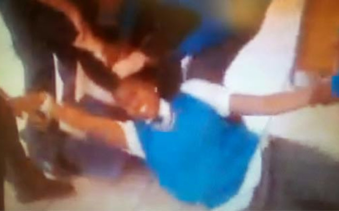 This screengrab from a cellphone video shows a Höerskool Patriot pupil being attacked by a teacher.