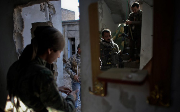 FILE:A fighter of the Syrian Kurdish People's Protection Units (YPG) prepare to fight against Islamic State (IS) group on 7 November, 2014 in the Syrian besieged border town of Ain al-Arab (known as Kobane by the Kurds). Picture: AFP.