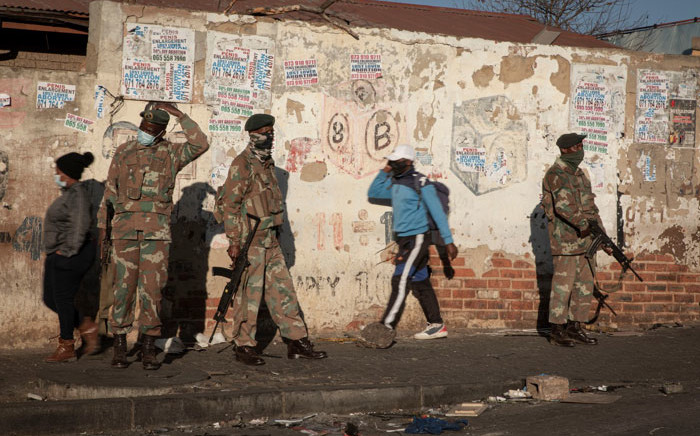 SANDF soldiers patrol in Alexandra on 13 July 2021 following incidents of rioting and looting in the area. Picture: Boikhutso Ntsoko/Eyewitness News