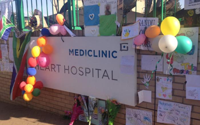 Messages of love and support for Nelson Mandela outside Pretoria's Heart Hospital on 17 June 2013. Picture: Christa van der Walt/EWN