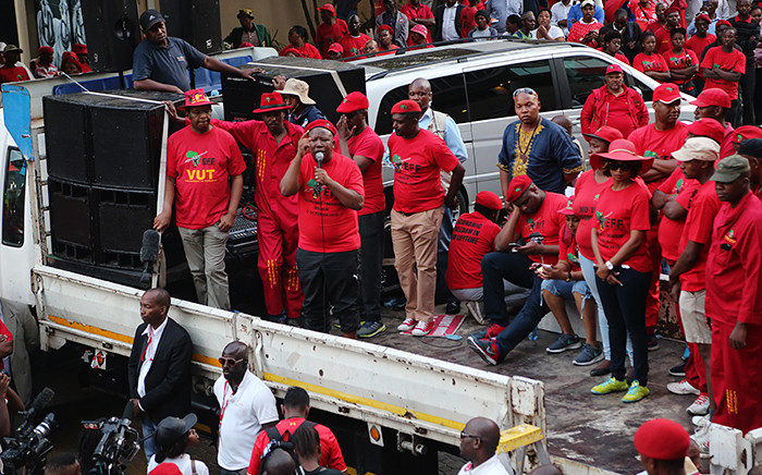 Party president Julius Malema addresses thousands of EFF supporters gathered outside the JSE in Sandton as part of their freedom march on 27 October 2015. Picture: Reinart Toerien/EWN.