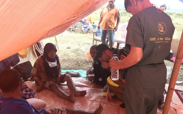 This is 38-year-old Merlina who is living in a tent after the earthquake. She lives in Ngataburu where residents are understood to sometimes fight for water. It's a scarce resource here and not much aid has arrived this side of town. Picture: Ziyanda Ngcobo/EWN.