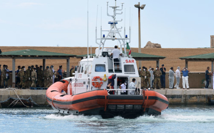 FILE: Boat of the Coast Guards arrives in the Lampedusa harbour on October 6, 2013 after divers recovered ten more bodies from the shipwreck that sank two days ago. Picture: AFP