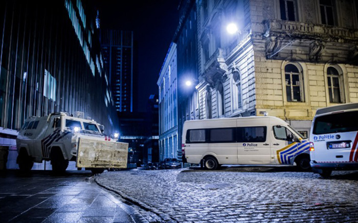 Belgian police vehicles are stationed near the Federal police building at Congress in Brussels on 15 January, 2015 after Belgian police shot dead two suspects in Verviers, eastern Belgium. Picture: AFP.