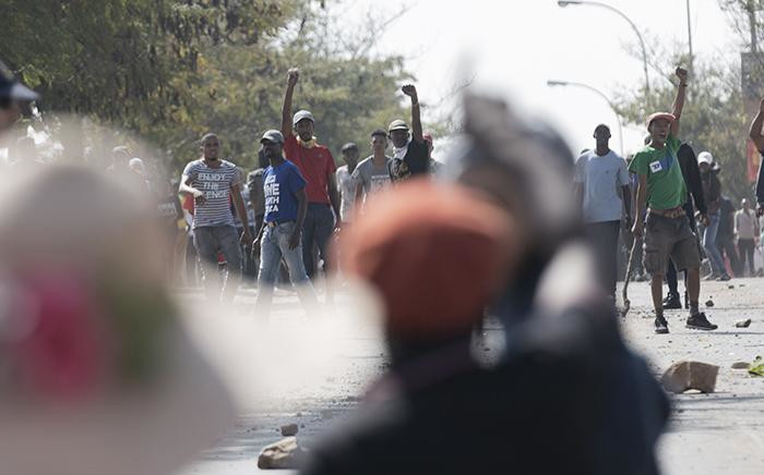 Rabie Ridge residents threw stones at police and journalists in the area which remains tense and violent. Picture: Sethembiso Zulu/EWN