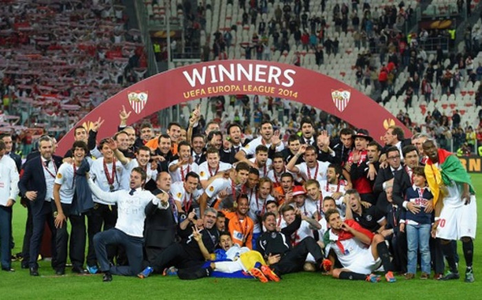 Sevilla players and staff celebrate winning the 2013/14 UEFA Europa League. Picture: Facebook.com