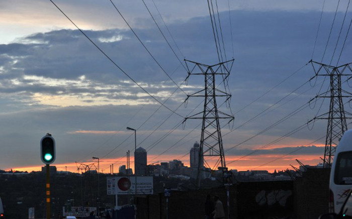 Power lines are pictured in Johannesburg on 27 March, 2011. The global fight over fossil fuels has hit home in South Africa as the coal-dependent country debates its energy future before hosting UN climate talks. Picture: AFP.
