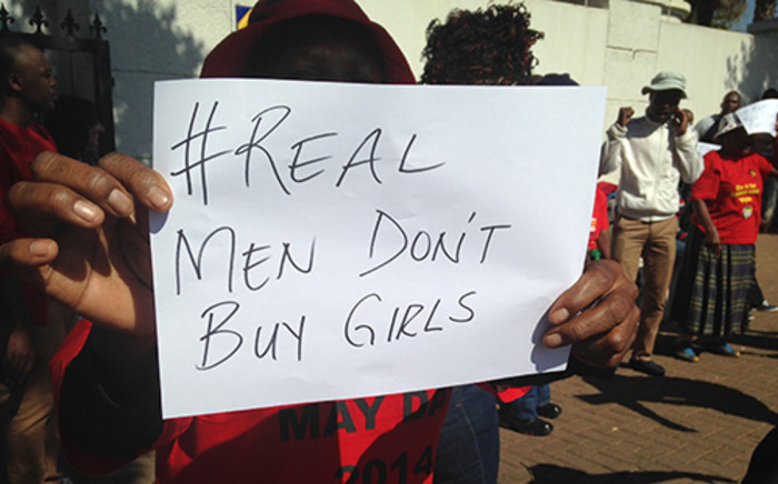 A woman holds up a poster as members of the Young Communist League hand over a memorandum, about the missing Nigerian schoolgirls abducted by militant group Boko Haram, at the Nigerian high commission in Pretoria on 19 May 2014. Picture: Reinart Toerien/EWN