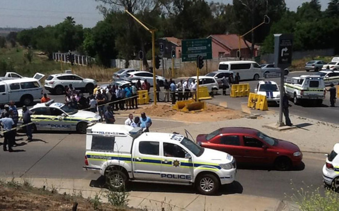 FILE: Police cars at the scene where officers in a police helicopter shot two suspects on the N1 north after a foiled robbery on 30 October 2014. Picture: Gia Nicolaides/EWN.