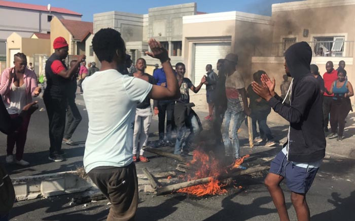 Khayelitsha residents singing during a service delivery protest on 11 April. Picture: Kaylynn Palm/EWN