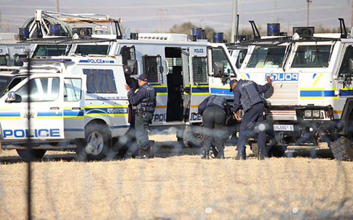 Police closely monitor protests in Marikana in the North West on 14 August 2012. Picture: Taurai Maduna/EWN.