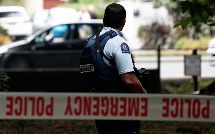 FILE: A police officer secures the area in front of the Masjid al Noor mosque after a shooting incident in Christchurch on 15 March 2019. Picture: AFP.
