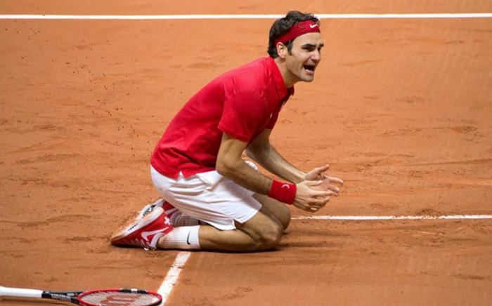 Switzerland's Roger Federer celebrates after beating France's Richard Gasquet at the Davis Cup final between France and Switzerland at Stade Pierre Mauroy in Villeneuve-d'Ascq, northern France, on November 23, 2014. Picture: AFP.