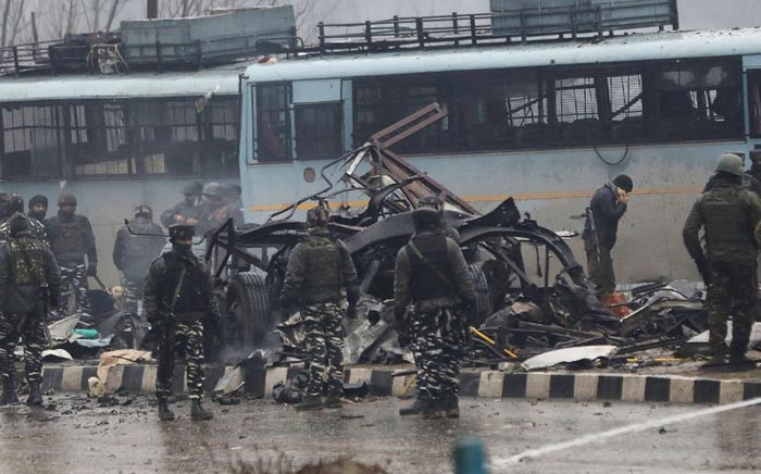 Indian security forces inspect the remains of a vehicle following an attack on a paramilitary Central Reserve Police Force (CRPF) convoy that killed at least 16 troopers and injured several others in Kashmir on 14 February 2019. Picture: AFP.