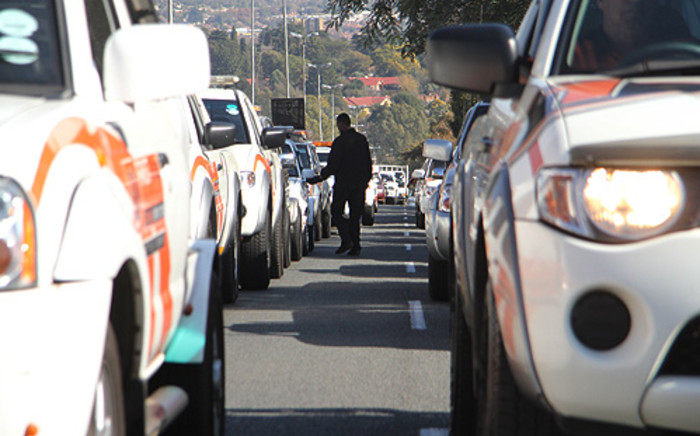 Tow truck drivers in a procession to the Retail Motor Industry (RMI) offices in Randburg. Picture: Taurai Maduna/EWN