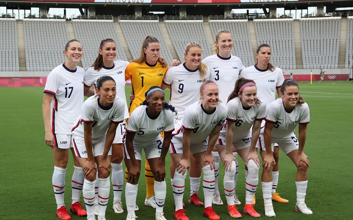 (From L, front) USA's forward Christen Press, USA's defender Crystal Dunn, USA's defender Becky Sauerbrunn, USA's midfielder Rose Lavelle, USA's defender Kelley O'Hara and (From L, Rear) USA's defender Abby Dahlkemper, USA's forward Alex Morgan, USA's goalkeeper Alyssa Naeher, USA's midfielder Lindsey Horan, USA's midfielder Samantha Mewis and USA's forward Tobin Heath pose for a team photo prior to the Tokyo 2020 Olympic Games women's group G first round football match between Sweden and USA at the Tokyo Stadium in Tokyo on July 21, 2021. Picture: Yoshikazu Tsuno / AFP