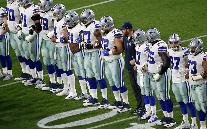 FILE: Dallas Cowboys players link arms during the singing of the US national anthem ahead of their NFL game against the Arizona Cardinals on 25 September 2017. Picture: @dallascowboys/Twitter