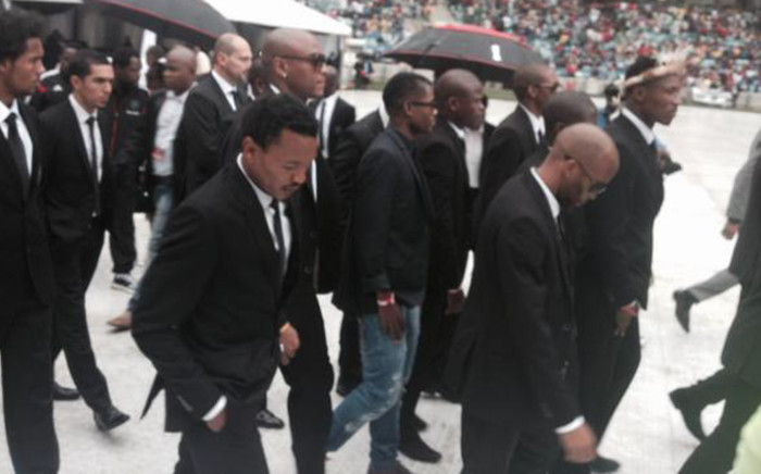 Orlando Pirates players follow behind the casket of Senzo Meyiwa. Picture: Marc Lewis