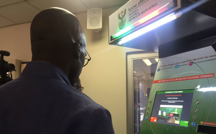 Home Affairs Minister Malusi Gigaba views an Automated Asylum Seekers Booking Terminal which will be used to automate booking at the Marabastad refugee reception office in Pretoria. Picture: Dineo Bendile/EWN.