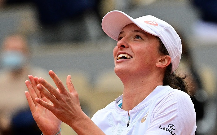 Poland's Iga Swiatek celebrates after winning against Sofia Kenin of the US during their women's singles final tennis match on Day 14 of The Roland Garros 2020 French Open tennis tournament in Paris on October 10, 2020. Picture: AFP