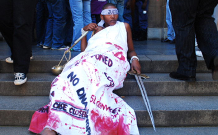 'Lady Justice' from POWA demonstrate's outside the Johannesburg High Court on 6 March, 2009. Picture: Taurai Maduna/Eyewitness News