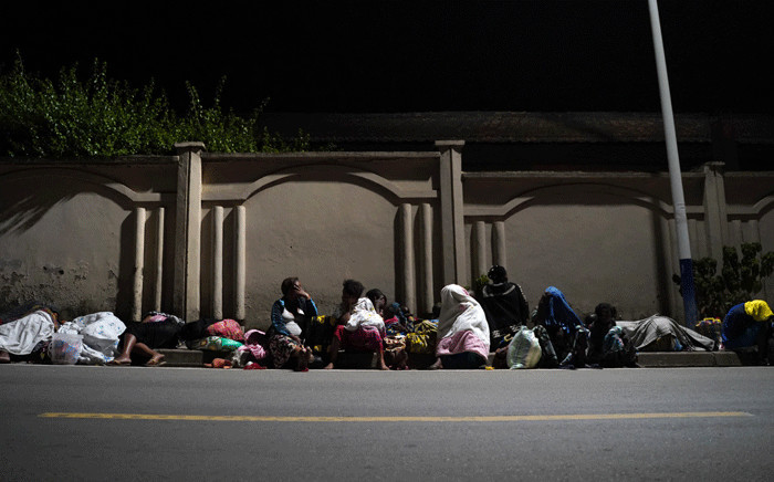 Congolese fleeing from Goma, Democratic Republic of Congo (DRC), sleep with their belongings on a street after the Nyiragongo volcano erupted near the border in Gisenyi, Rwanda, on May 23, 2021. Picture: Simon Wohlfahrt / AFP