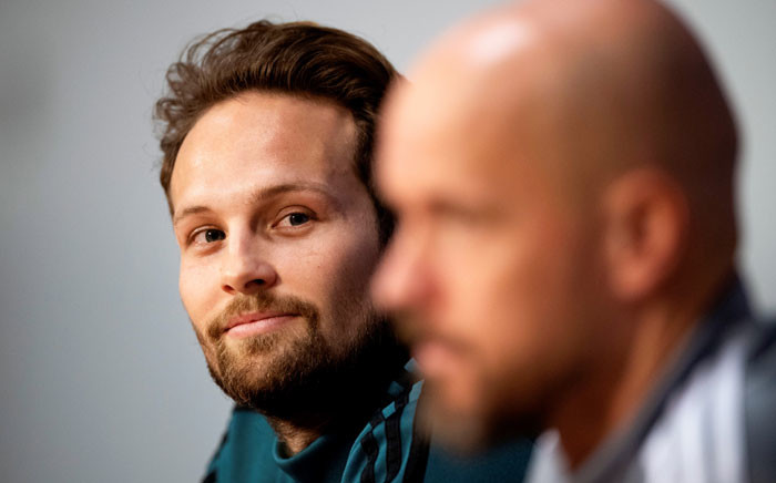 Ajax' Dutch defender Daley Blind (L) and Ajax' Dutch Erik ten Hag (R) attend a press conference in Amsterdam, on 22 October 2019 on the eve of the Uefa Champions League football match between Ajax Amsterdam and Chelsea. Picture: AFP