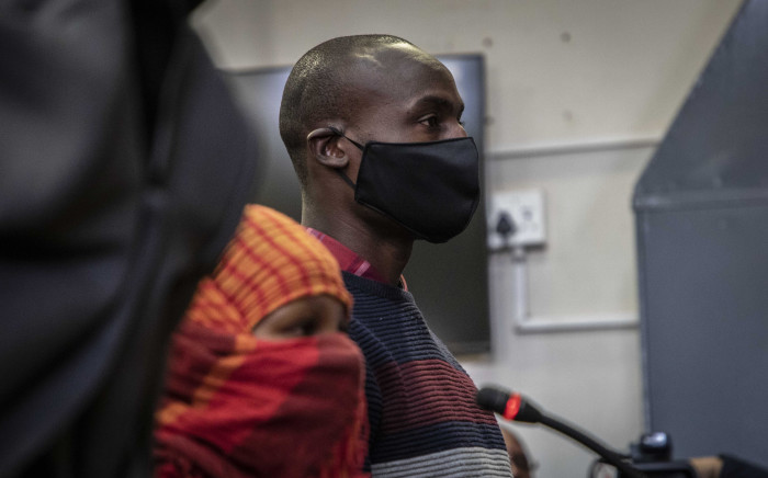 Voster Netsiongolo, one of the three police officers accused of murdering Nathaniel Julies (16), appears at the Proteas Magistrates court on 22 September 2020. Picture: Abigail Javier/EWN