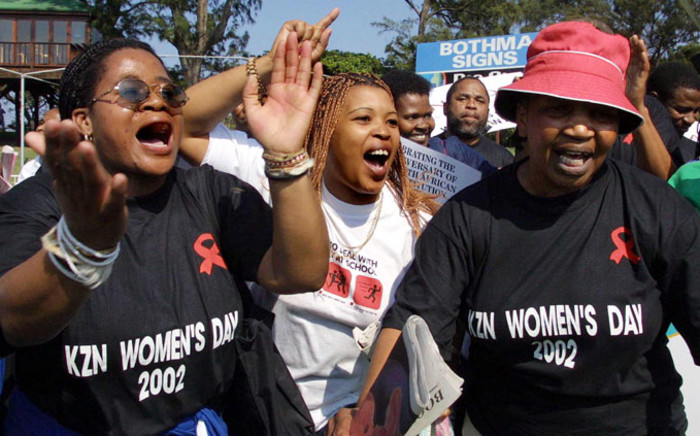 FILE: Hundreds of women march in Durban to commemorate National Women's Day 9 August 2002 to remember those who died in the struggle in defeating apartheid. Picture: AFP