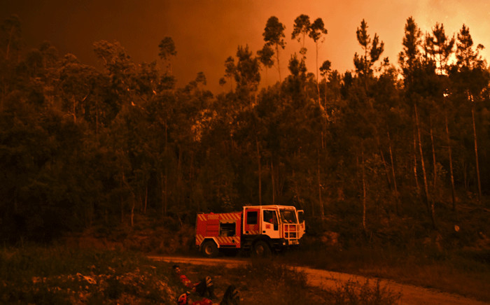 Firefighters rest during a wildfire at Penela, Coimbra, central Portugal, on 18 June 2017. Picture: AFP