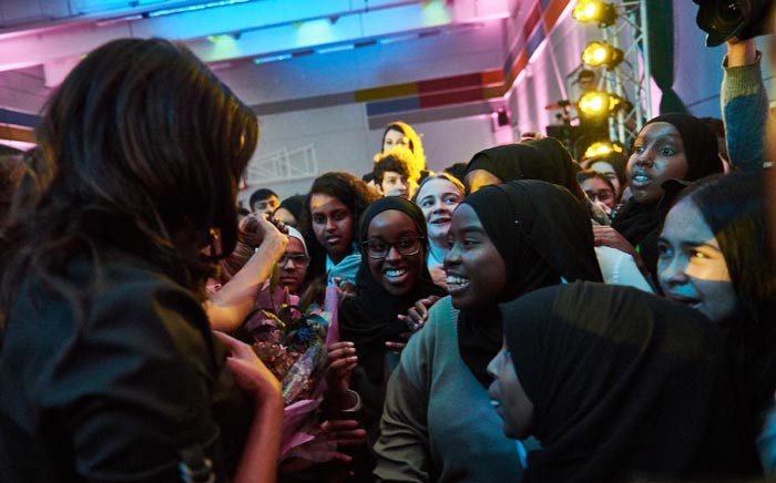 Michelle Obama, left, engaging with school pupils during a visit at a London school. Picture: @MichelleObama/Twitter