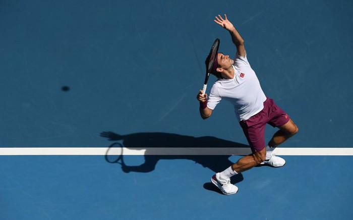 FILE: Switzerland's Roger Federer hits a return against Tennys Sandgren of the US during their men's singles quarter-final match on day nine of the Australian Open tennis tournament in Melbourne on 28 January 2020. Picture: @AustralianOpen/Twitter