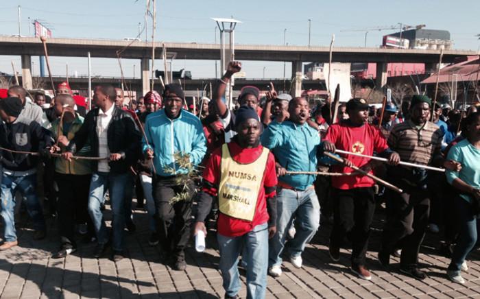 FILE: Numsa members on strike in Johannesburg on 1 July 2014. Picture: Sebabatso Mosamo/EWN.