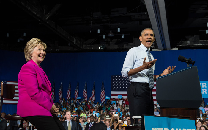FILE: US President Barack Obama speaks at a campaign event for Democratic presidential candidate Hillary Clinton (L) in Charlotte, North Carolina, on 5 July, 2016. Picture: AFP.