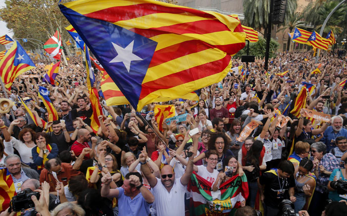 FILE: People celebrate after Catalonia's parliament voted to declare independence from Spain in Barcelona on 27 October, 2017. Picture: AFP