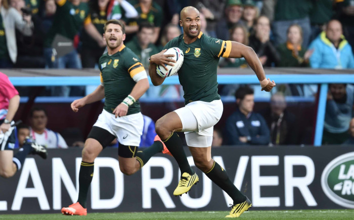 JP Pietersen (R) scores his first of three tries during the Pool B match of the 2015 Rugby World Cup between South Africa and Samoa at Villa Park in Birmingham on September 26, 2015.
