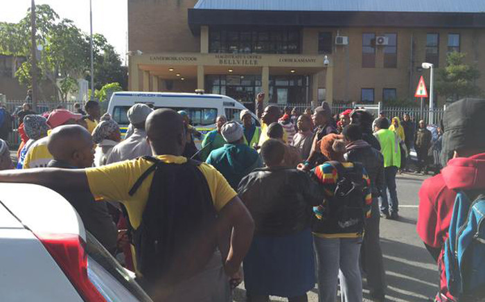 FILE: A small group of Andile Lili's supporters outside Bellville Magistrate Court during his court appearance on 31 July 2015. Picture: Siyabonga Sesant/EWN.
