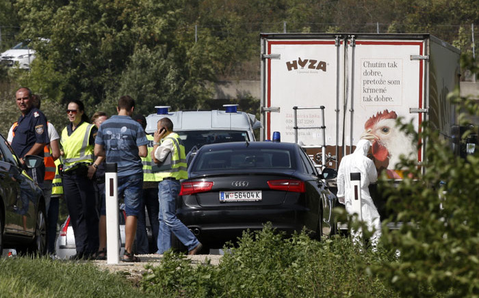 An abandoned refrigerated lorry filled with corpses of migrants was found by an Austrian motorway patrol near the Hungarian border on 27 August 2015. Picture: AFP