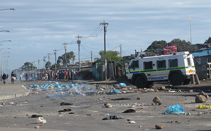 Police maintained a strong presence int he Nyanga after violent service delivery protests where residents burned tyres. Picture: Nathan Adams/EWN