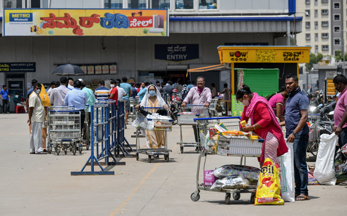People buy groceries at a supermarket during the first day of the 21-day government-imposed nationwide lockdown as a preventive measure against the spread of the COVID-19 coronavirus, in Bangalore on 25 March 2020. Picture: AFP