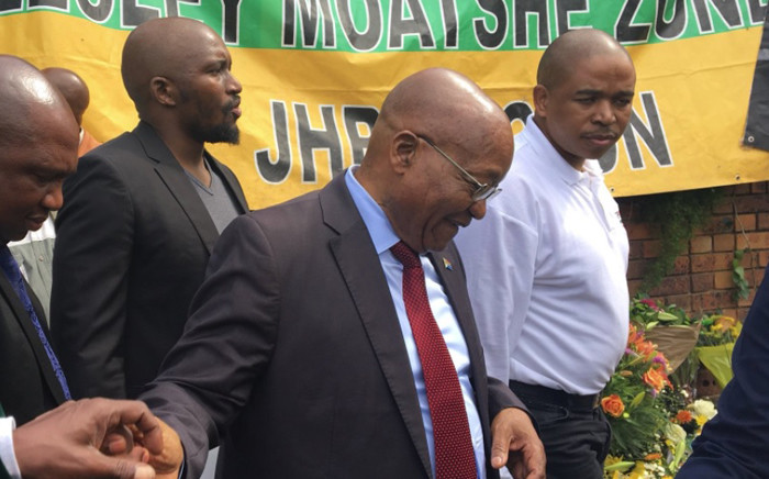 Former President Jacob Zuma greets ANC supporters outside late struggle stalwart Winnie Madikizela-Mandela's home in Soweto. Picture: Gia Nicolaides/EWN