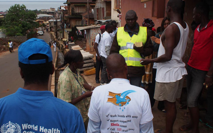 WHO observers during their house-to-house Ebola awareness campaign teams in SierraLeone. Picture: Official WHO Facebook page.