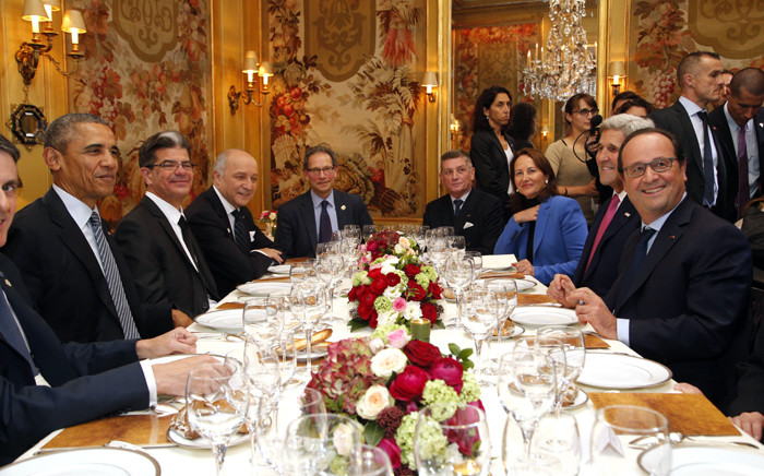 President Barack Obama (L) and French President Francois Hollande (R) have dinner at the Ambroisie restaurant in Paris, with Secretary of State John Kerry (2nd R), French Minister for Ecology, Sustainable Development and Energy Segolene Royal, (3rd R) and French Foreign Minister, Laurent Fabius, (2nd L) as part of the COP21 World Climate Change Conference in Le Bourget, north of Paris, on 30 November, 2015. Picture: AFP.