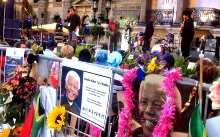 Capetonians hold a vigil for Nelson Mandela at the Grand Parade, 14 December 2013. Picture: Mia Spies.